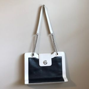 Escalated black and white purse